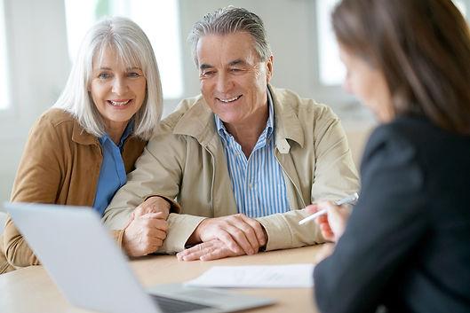 Senior couple meeting financial adviser for investment                .jpg