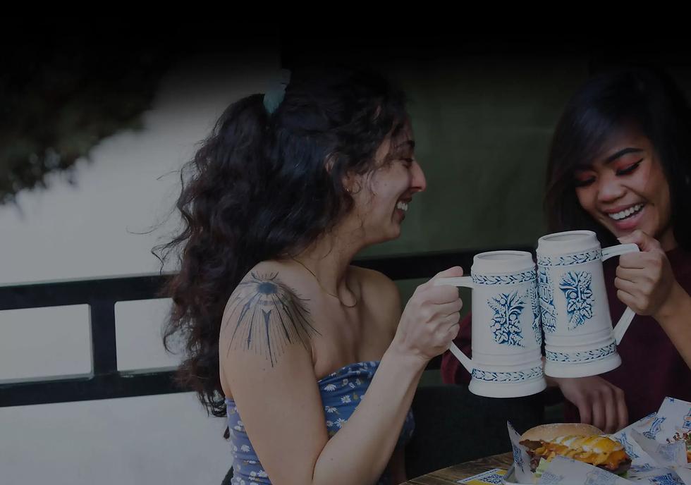 Two girls cheering for mug club