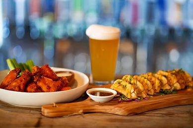 Photo of chicken wings beer and potstickers