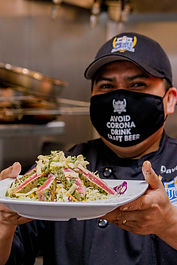 University of Beer Chef Holding Seared Ahi Salad
