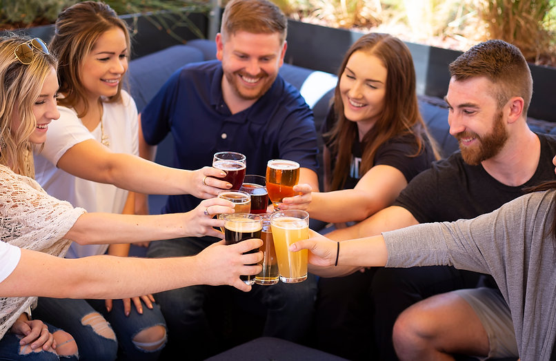 A group of people cheering beer at UOB Rocklin location