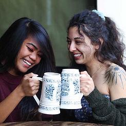 Girls enjoying beer in Mug Club mugs