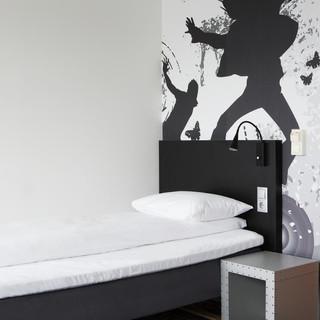standard-single-room-bed-gray-bedside-ta