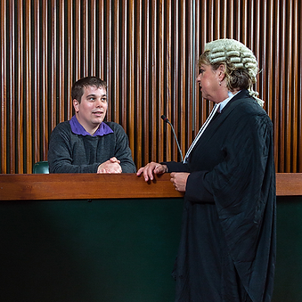 A Court Barrister talking with a Victim in Court
