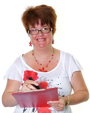 An image of a female member who is smiling at the camera. She is holding a clipboard and a pen