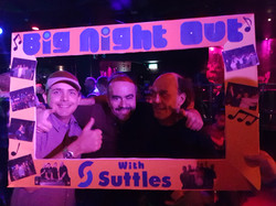 3 male friends enjoying the club night, using the selfie frame