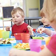Pre School Children Eating Healthy Snack