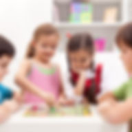 Children playing board game - sitting ar