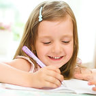 cute happy little girl writing something