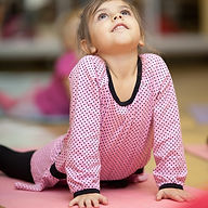 5 year old little girl doing sports exer