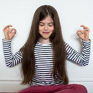 cute little girl meditating_