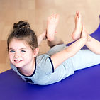 Little girl doing sports on mat..jpg