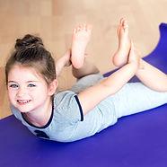 Little girl doing sports on mat..jpg