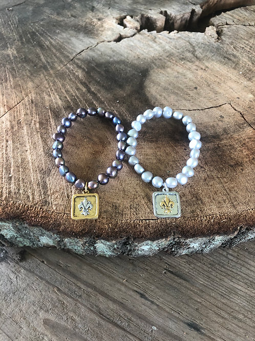 pearls with fleur de lis charm