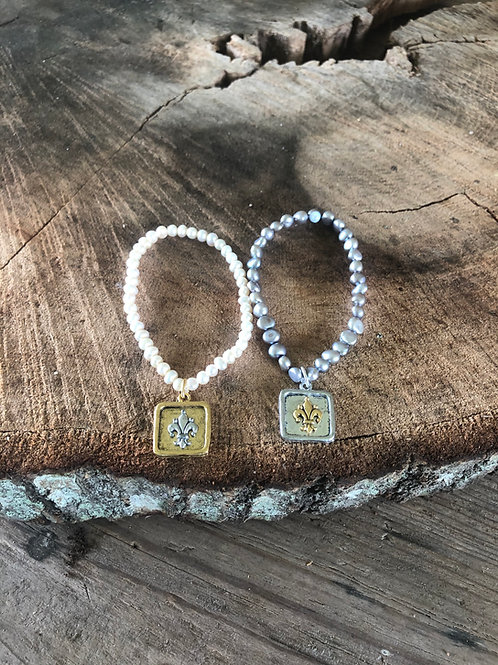 small pearls with fleur de lis charm