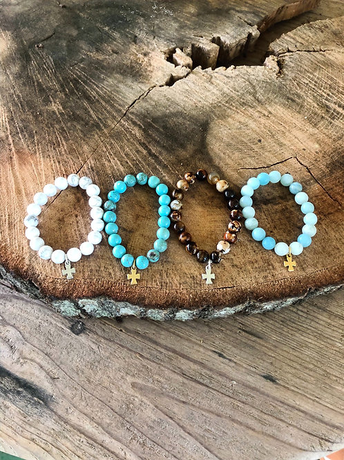 stone beads with tiny cross