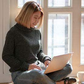 _Teacherswoman-in-gray-sweater-sitting-o