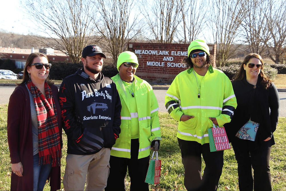Pat's Body Shop Manager Dustin Shoaf with Meadowlark Crossing Guards