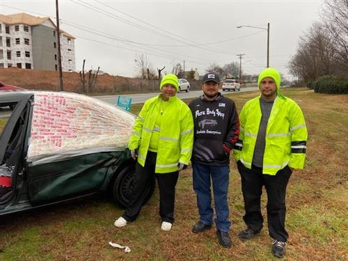 Pat's Body Shop Manager Dustin Shoaf with Meadowlark Crossing Guards and Car in Need of Repair