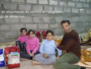 Entrega de alimentos básicos a refugiados
