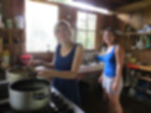 Volunteers cooking and helping in the kitchen at nature reserve and biological station in Ecuador-South America.
