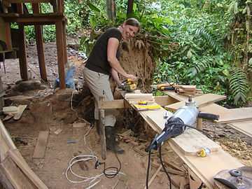 Volunteer helping with carpentry work at nature reserve and biological station in Ecuador-South America.