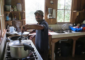 Wilo cooking lunch at biological station Un poco del Chocó in Ecuador South America