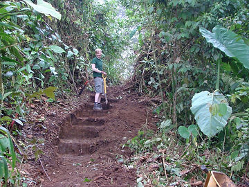 Volunteer working on trail in nature reserve and biological station in Ecuador-South America.