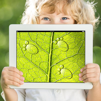 Happy child holding tablet PC with photo