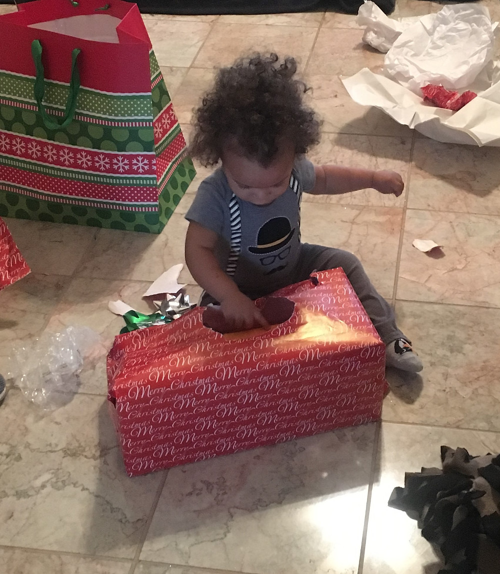 Beckett playing with the Christmas wrapping