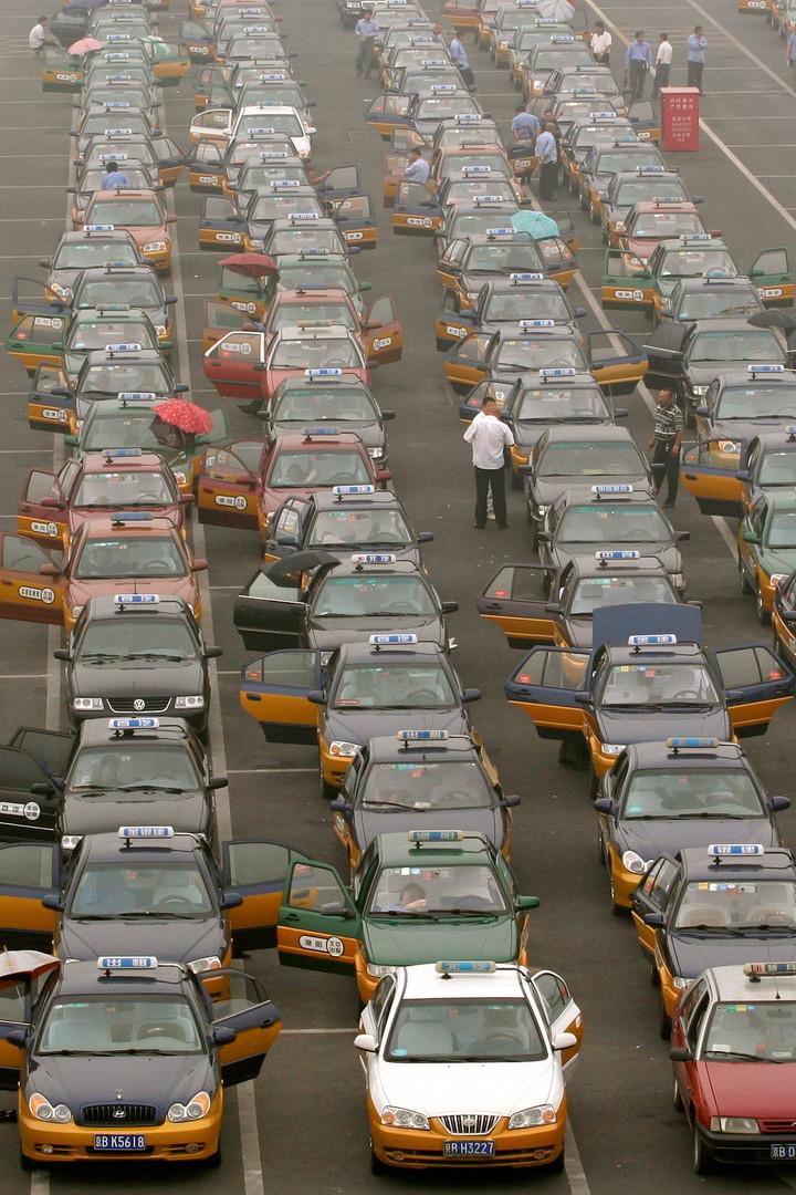 27 Taxi drivers queue at a parking lot w