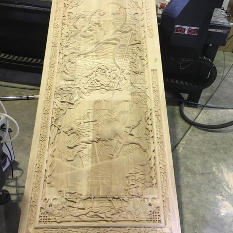 finsihing carving door.jpg