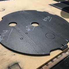 cnc-cut-carbon-fiber-ring-with-holes.JPG