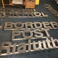 halo-lit-border-crossing-letter-on-rails