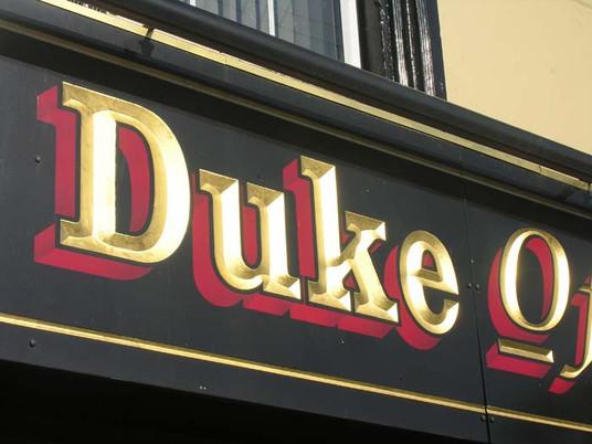duke carved sign