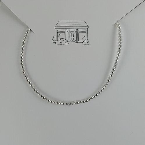 plain 2mm beaded silver stretchy bracelet