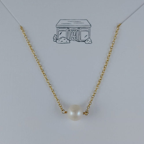 pearl on a gold-filled necklace