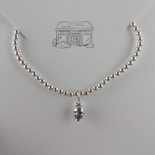'skull' charmed 3mm stretchy bracelet
