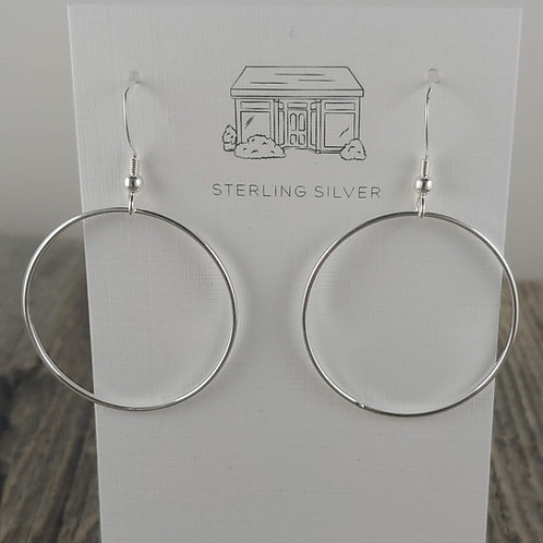 swinging 'ring' earrings