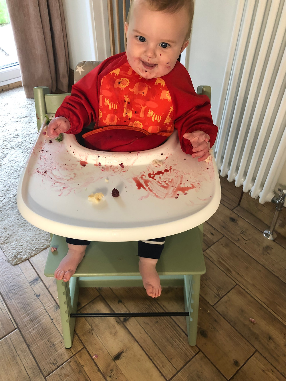 Premature baby weaning in high chair introducing solids