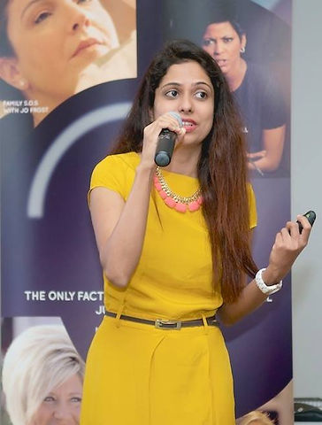 Sweta Rai speaking at a conference at Discovery Channel