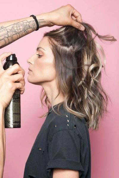 rab a can of texturizing spray or dry shampoo — Tran prefers Oribe's Dry Texture Spray — and blast the roots of your hair, holding the spray 12 inches away from your head. Go section by section, and slowly layer the spray into your locks, avoiding the ends.: