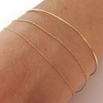 Pønt 18K Gold arm ring and silk cord bracelets selected by @moda_rama: