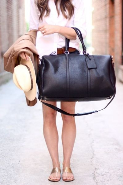 This black vegan leather weekender bag can actually fit everything you've ever wanted for your next getaway.: