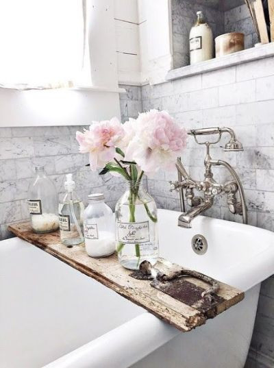 Marble subway tile with claw-footed tub in this beautiful bathroom.: