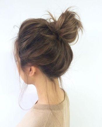 Master the messy bun with @StyleCaster's hair inspiration roundup | loose bun medium hair: