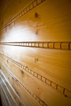 Detail na drevené steny Penziónu