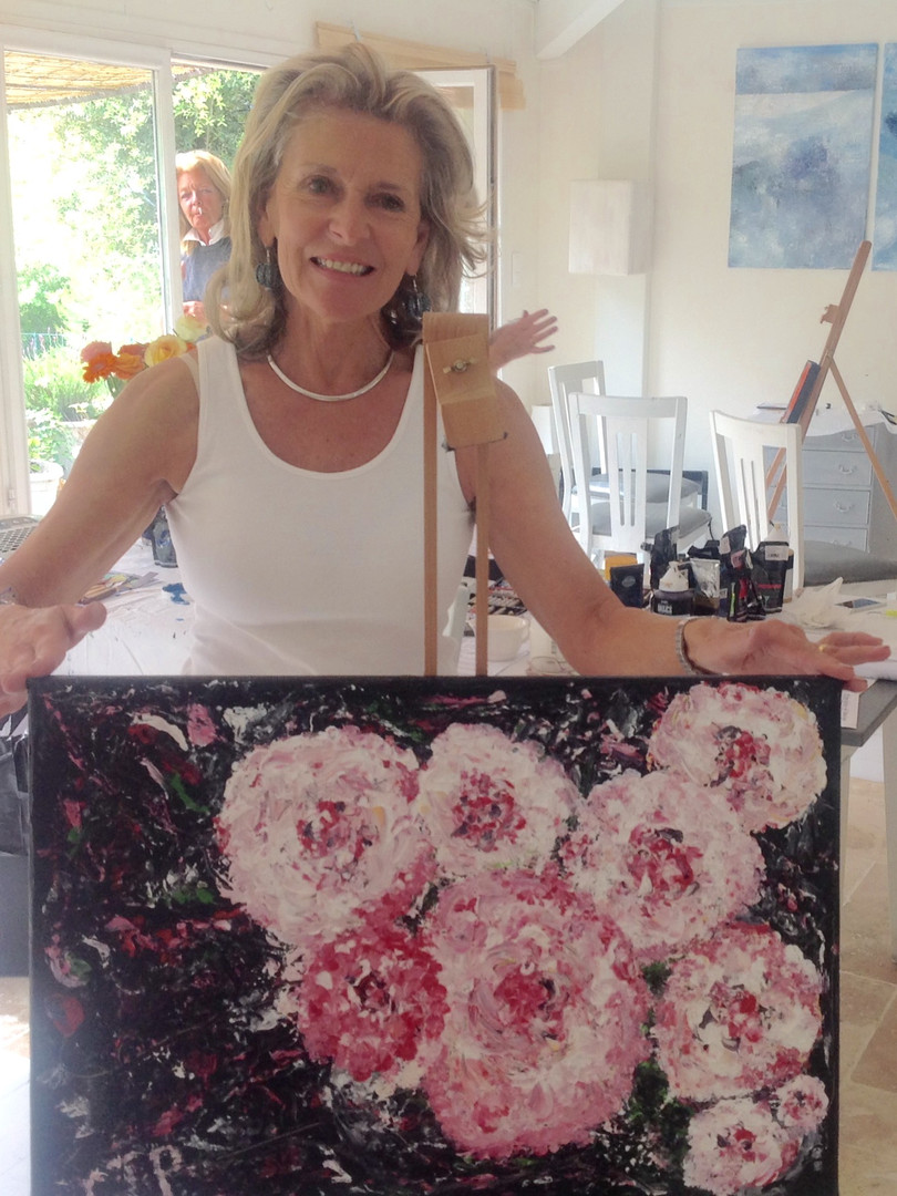 Happy artist with her painting