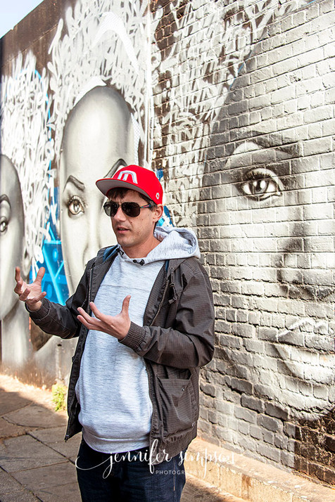 Artist 'Mars' in front of his graffiti work