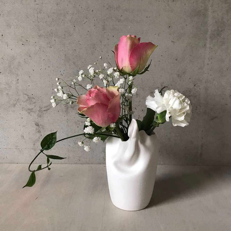 twisted vase with roses